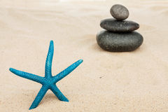 Starfish and the pyramid on the sand Stock Photos