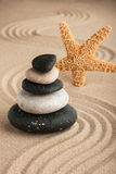 Starfish and the pyramid on the sand Royalty Free Stock Photo