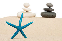 Starfish and the pyramid on the sand Stock Images