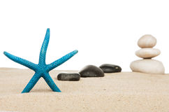 Starfish and the pyramid on the sand Royalty Free Stock Image