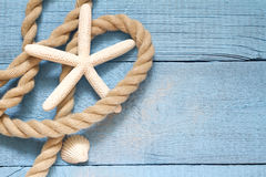 Starfish and rope on blue boards abstract Stock Photos