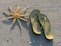 Starfish and sandals Royalty Free Stock Images