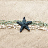 Starfish on sea sand Stock Photography