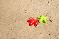 Starfish-shaped molds on the sand Stock Photos