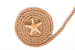 Starfish and ship ropes Stock Images