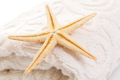 Starfish on soft white towel Stock Photo