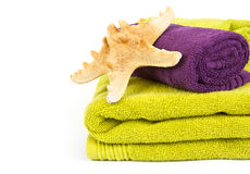 Starfish on stack of colorful towels Stock Photos