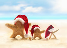 Starfish on summer beach and Santa hat Royalty Free Stock Image