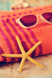 Starfish, sunglasses and beach towel Royalty Free Stock Image