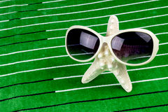 Starfish with sunglasses Royalty Free Stock Photos