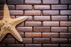 Starfish  textured wooden table mat copy space sauna concept Stock Photos