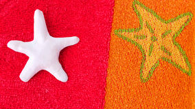 Starfish on towel Royalty Free Stock Images