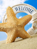 Starfish and welcome sign on beach Royalty Free Stock Photography