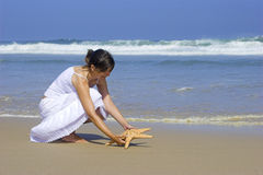 Starfish woman Royalty Free Stock Images