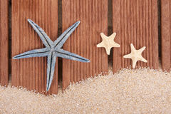 Starfish and wood Royalty Free Stock Images