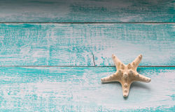Starfish on wooden background Royalty Free Stock Photography