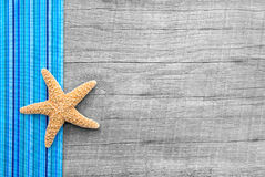 Starfish on wooden background in shabby style Royalty Free Stock Image