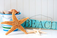 Starfish and wooden beach sign stock image