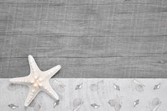 Starfish on wooden grey surface - wooden background for a vouche Royalty Free Stock Photography