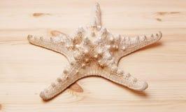 Starfish on a wooden table. Souvenir Stock Photos