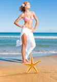 Starfish and young woman at the beach Stock Images