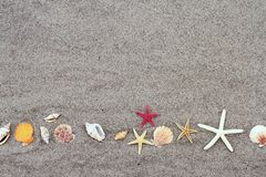 Starfishes on beach sand Royalty Free Stock Photos
