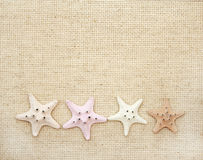 Starfishes on canvas texture Stock Images