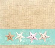 Starfishes on canvas texture Stock Photo