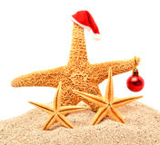 Starfishes, christmas bauble on the sand. Isolated on white royalty free stock photos