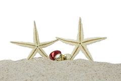Starfishes and christmas bells on sand Stock Images