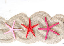 Starfishes on sand Royalty Free Stock Photography