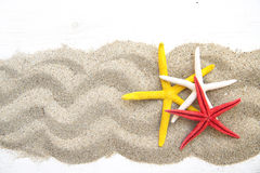 Starfishes on sand Stock Images