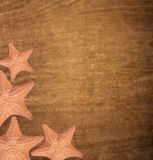 Starfishes on wooden background Royalty Free Stock Photography