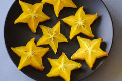 Starfruit cut open on a plate Royalty Free Stock Images