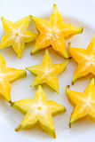 Starfruit Slices. On a white plate Royalty Free Stock Images
