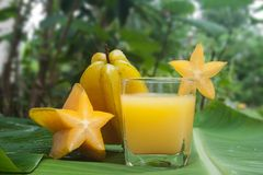 Starfruit and Starfruit juice. Royalty Free Stock Image