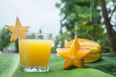 Starfruit and Starfruit juice. Stock Images