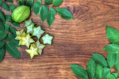 Starfruit on woodboard Royalty Free Stock Photography
