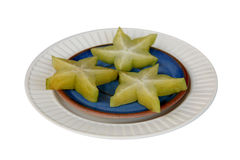 Starfruits op blauwe en witte platen Stock Foto's