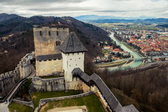 Stari grad of Celje, Slovenia. Bridge over the Savinja river. Aerial view of city historical center from the castle Royalty Free Stock Photography