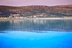 The mountainous coast of one of the Croatian islands against the purple sky after sunset. stock photography