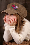 Staring. A young girl staring off into the distance royalty free stock photography