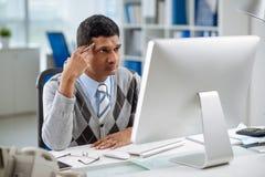 Staring at computer screen Stock Photo