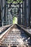 Staring down railroad tracks. Across bridge Royalty Free Stock Photos