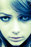 Staring face. Close-up portrait of a teen girl staring intensively Stock Images