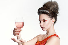 Staring at the glass. Young beautiful girl staring at a glass of wine Royalty Free Stock Images