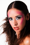 Staring mixed raced girl with extreme make-up stock image