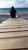 Man figure staring at the sea. Blue sea ocean sky Stock Images