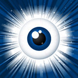 Staring spy eyeball on star burst background Stock Photography