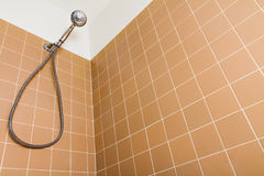Staring up to the shower head Royalty Free Stock Images